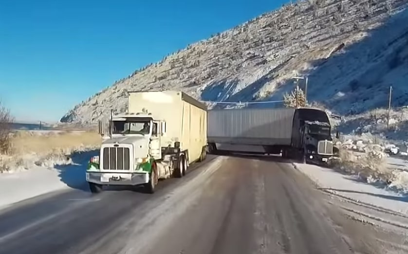 Truck Driver Drives Straight Into A Clusterf*ck Situation, Somehow Comes Out Of It Unscathed