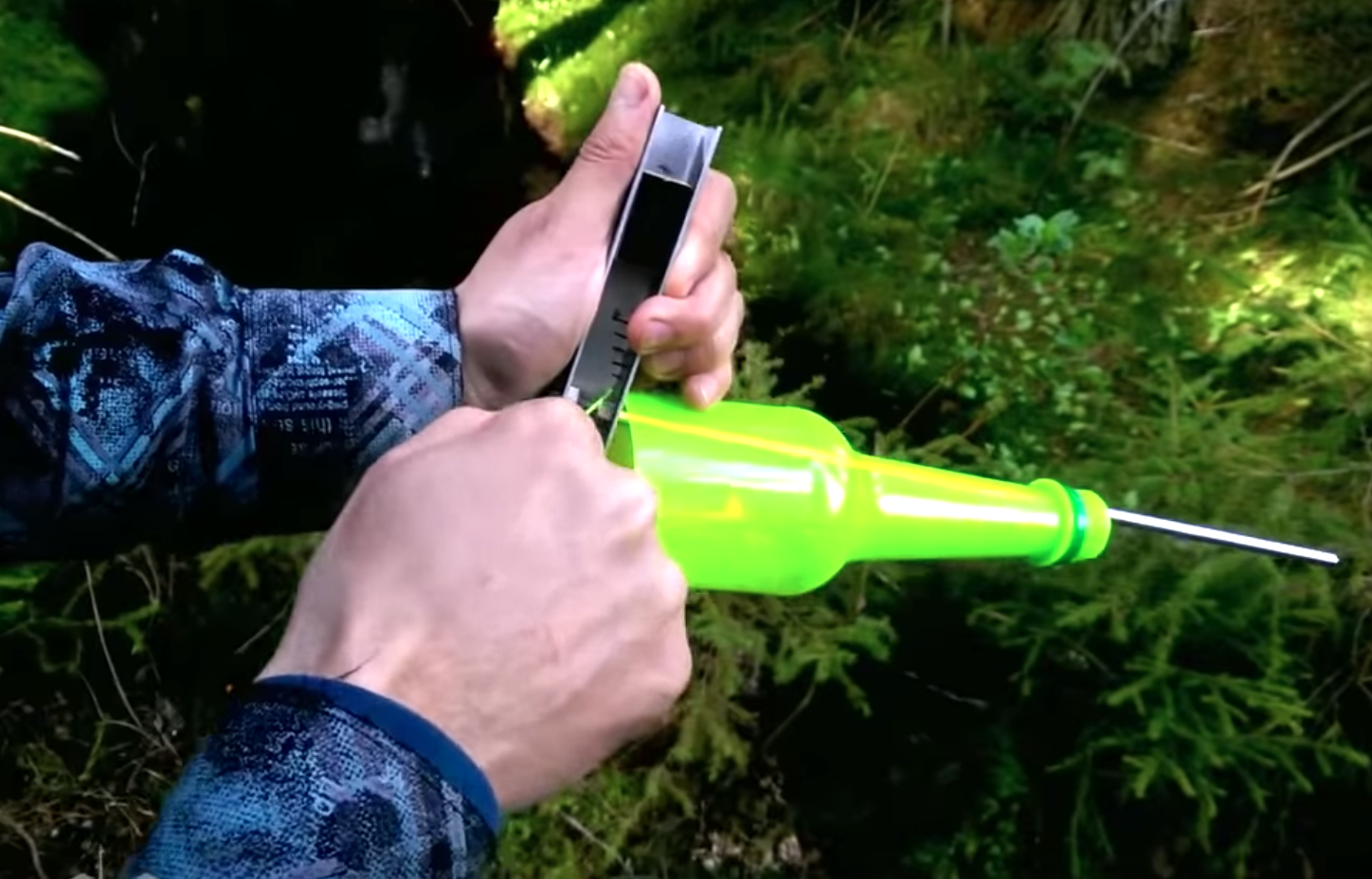Russian Man Demonstrates How To Fish In The Wild Using A Plastic Bottle