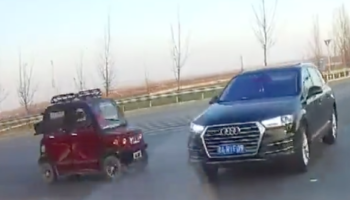 Confrontation Between A Teeny Tiny Car And Audi SUV Does Not Go As Expected