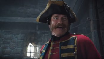 Arnold Schwarzenegger And Jackie Chan Face Off In The Bonkers Trailer For 'The Iron Mask'