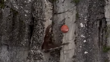 Watch This Wrecking Ball Come In Like A Wrecking Ball And Wreck An Unstable Piece Of Rock