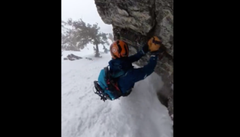 Snowboarder Senses An Avalanche Is Near, Clings To Rockface To Keep Himself Safe