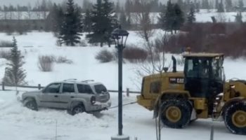 Tractor Tows SUV Out Of Snow Drift… And Obliterates Its Back Window