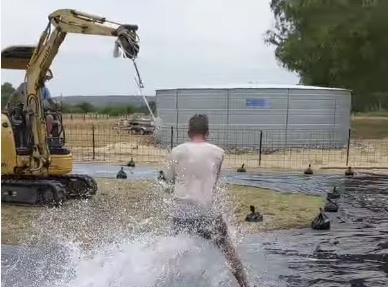 Kid Has The Time Of His Life Using An Excavator For A Slip 'N Slide