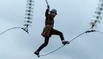 Don't Watch This Video Of An Engineer Servicing Electric Wires If You're Even A Little Bit Afraid Of Heights