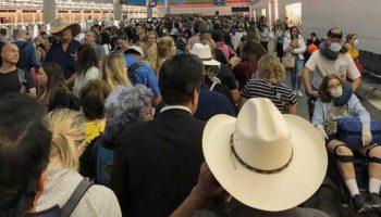 Travelers Greeted With Hours-Long Airport Lines As Coronavirus Screenings Begin