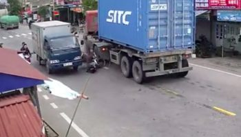 Motorcyclists Get Ping Ponged Between Two Trucks