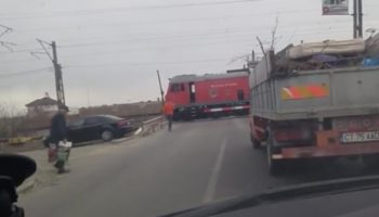 Train Conductor Holds Up Traffic At Rail Crossing To Make A Pit Stop For Coffee