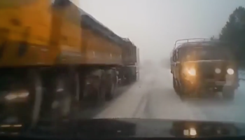 Driver Is Forced To Drive Between Two Oncoming Trucks, Handles It Like A Champ