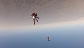 Insane Footage Of One Skydiver Rocketing Into Another, Knocking Him Out Cold Mid-Jump
