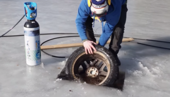 Here's What Happens If You Explode A Tire Under Ice In A Frozen Lake