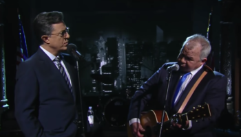 Stephen Colbert Shares Previously Unseen Duet With John Prine Singing 'That's The Way The World Goes Round'