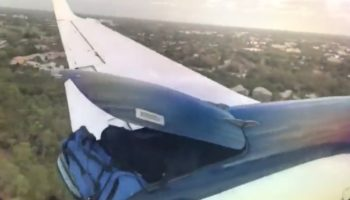 Passenger's Bag Hangs On For Dear Life After Pilot Fails To Secure Latch