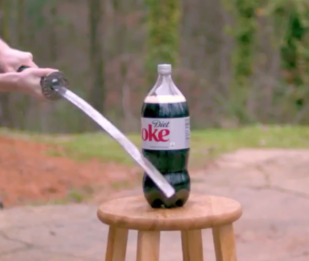 Here's What Happens When You Test A Cheap Katana Against A Soda Bottle
