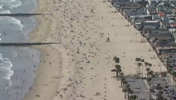 Tens Of Thousands Flock To Orange County Beaches As Heat Wave Lingers Over SoCal