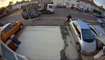 Man On The Sidewalk Narrowly Escapes Getting Crushed By A Flipped Car