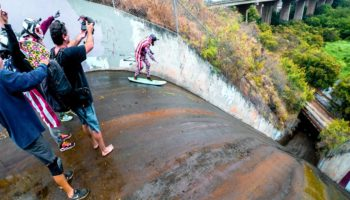 Guys Surf Down A Dangerously Steep Storm Drain, Wipe Out Hard