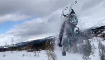 Guy Tries A Snowmobile Backflip, Totally Biffs It