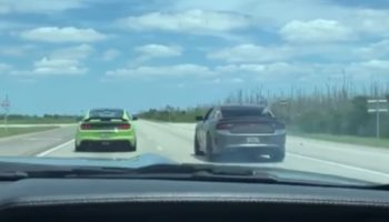 Dodge Charger Tries To Race A Ford Mustang On The Highway, Drives Straight Into A Ditch