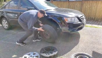 A Dad Gives An Incredibly Handy Lesson In Changing A Tire