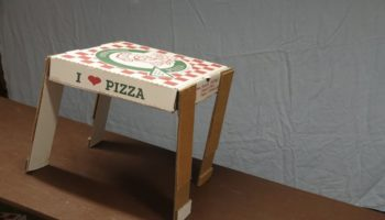 Here's A Clever Trick To Make A Pizza Box Walk Down A Ramp