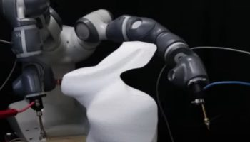 Here's A Two-Armed Robot Meticulously Carving Up A 3D Sculpture With Hot Cutting Wire
