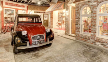 There's Life-Sized Fake Town Complete With Real Cars In This Mansion's Basement