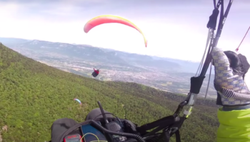 Watch Two Paragliders Crash Into Each Other Mid-Air