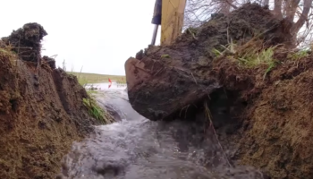 The Satisfying Moment When Years' Worth Of Water Is Unblocked After These Farmers Build A Culvert
