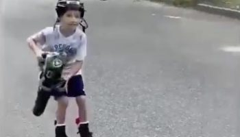 This Kid Is Having The Time Of His Life With A Leaf Blower And Roller Blades