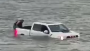Guys Make The Questionable Decision To Save A Sinking Boat With A Jeep And A Pickup Truck. Things Go As Well As You'd Imagine