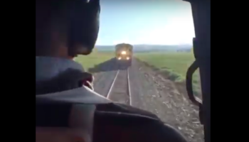 Watch A Helicopter Fly Above A Train At The Very Last Second