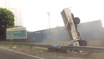 Trucks Hits A Road Barrier. Things Don't End Well For Truck