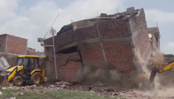 This Excavator Is *Way* Too Close To A Building That's Been Demolished