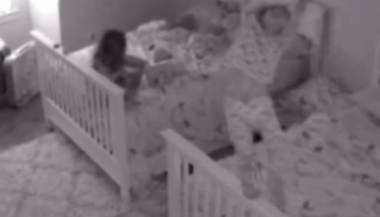 Little Girl Has A Little Too Much Fun With Chandelier In Nursery