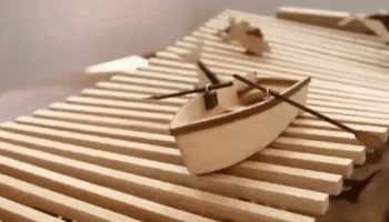 Watch This Wonderful Wooden Kinetic Wave Sculpture Animate This Little Boat And Jumping Fish