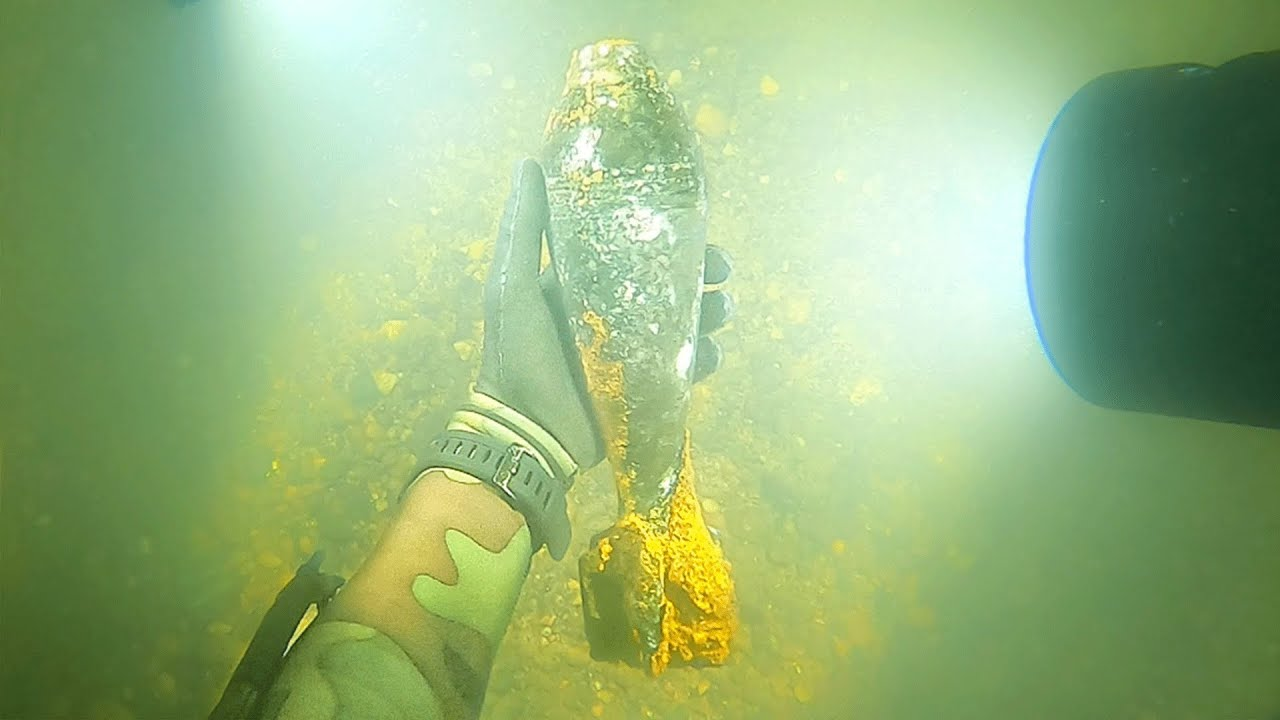 Scuba Divers Hunt Around Riverbed, Accidentally Find An Old Bomb