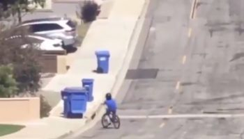 This Kid Crashing Into Garbage Cans Syncs Up Perfectly With The Drum Break In Phil Collins' 'In The Air Tonight'