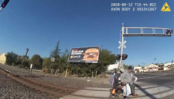 Cop Rescues Man Trapped On Train Tracks In The Nick Of Time