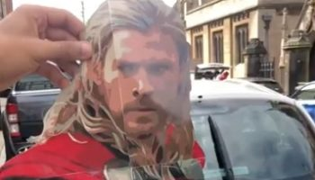 Guy Finds A Brilliant Use For This Thor Cardboard Cutout For His Car