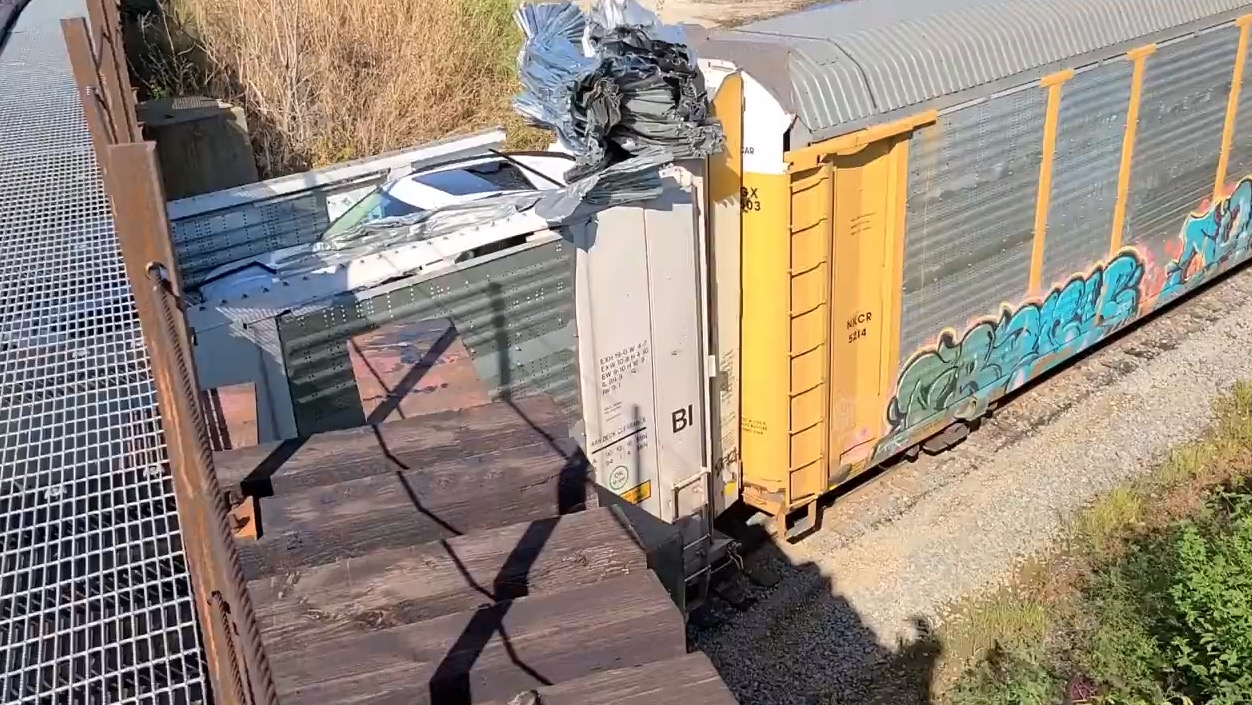 Train Tries To Go Under A Low Clearance Bridge, Eats It Good