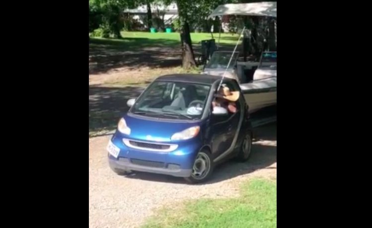 Maybe It's Not The Best Idea Backing A Boat Out A Driveway With A Smart Car