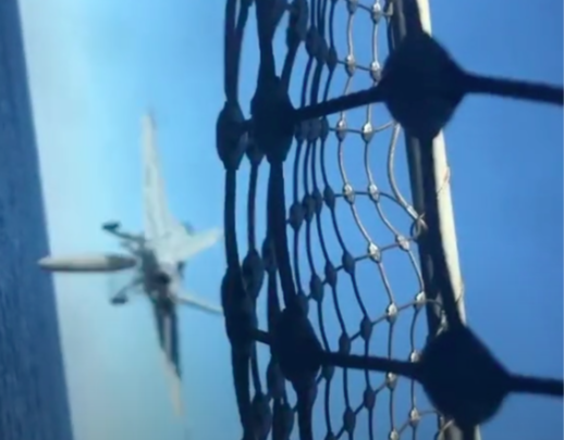 Watch A Combat Jet Jettison Its Fuel Tank Straight Into The Ocean