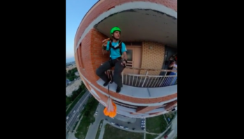 Guy Casually Does A BASE Jump From A Residential Building While Eating