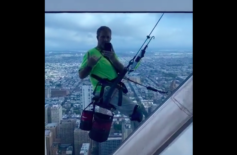 Window Cleaner Casually Films Himself Working Almost 1,000 Feet Above Ground
