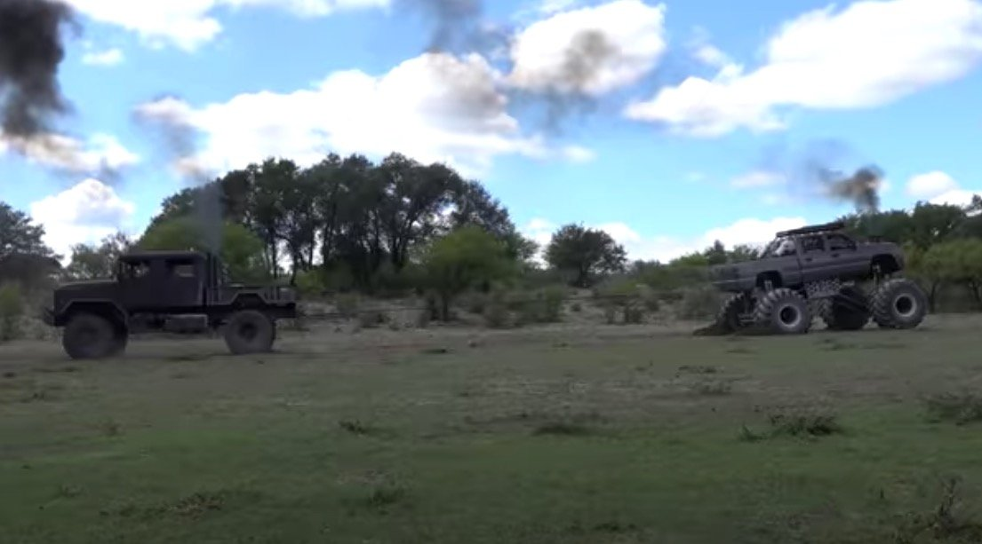 Military Truck Takes On A Monster Truck In A Epic Game Of Tug Of War