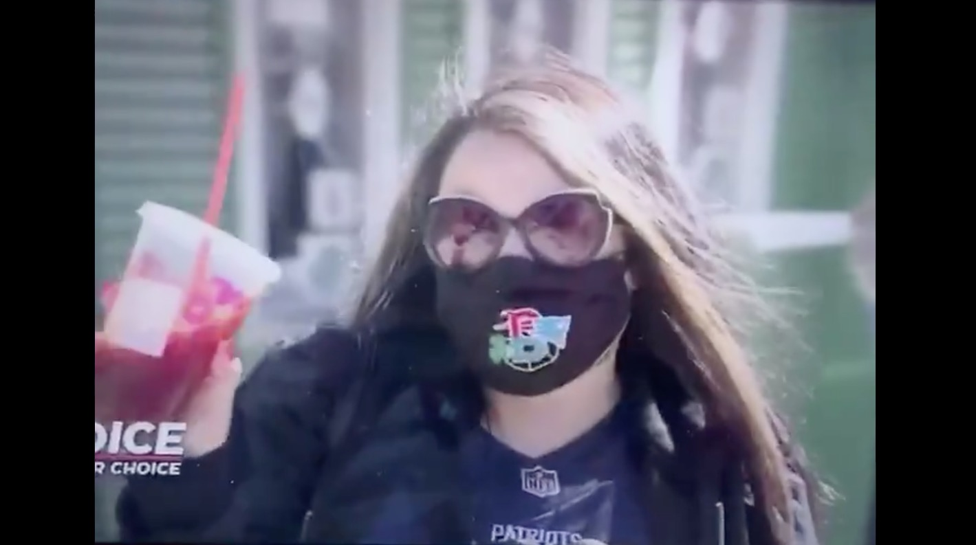 This Boston Woman Voting At Fenway Park While Sipping Her 'Dunkies' Is So Boston It Hurts