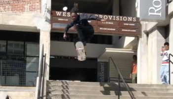 Skater Catches Mad Air While Jumping Over Stairs, Fans From Inside The Building Cheer Him On