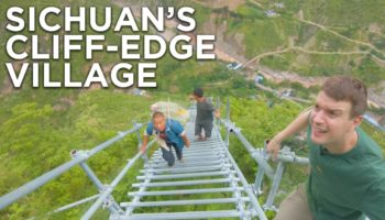 Guy Climbs A 2,556-Step Mountain Ladder In Sichuan, China, And It Looks Absolutely Terrifying
